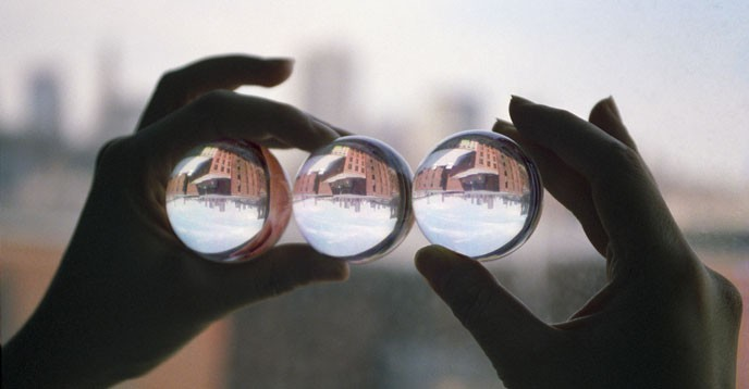 Three glass spheres reflecting the same reality.